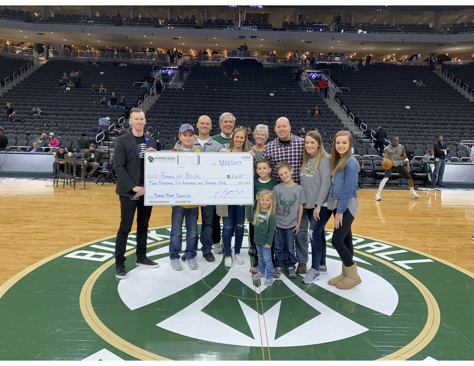 Band of blue getting a check at the Bucks game.