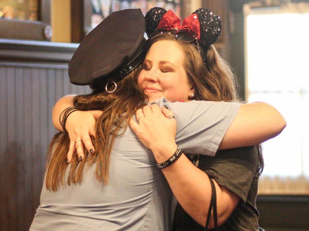 hugging police officer